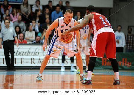 KAPOSVAR, HUNGARY - MARCH 8: Hrvoje Puljko (white 7) in action at a Hungarian Championship basketball game with Kaposvar (white) vs. Paks (red) on March 8, 2014 in Kaposvar, Hungary.