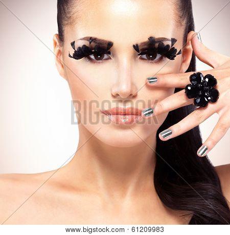 Face Of Beautiful Fashion Woman With  Black False Eyelashes