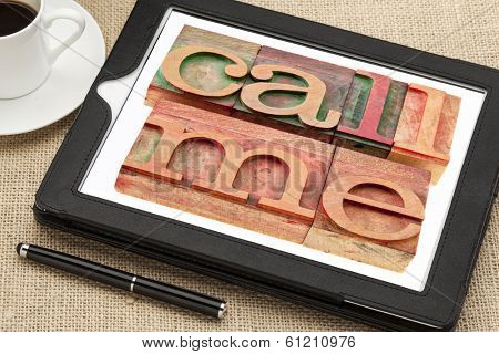 call me request or reminder  - words in vintage wooden letterpress printing blocks on a digital tablet with a cup of coffee