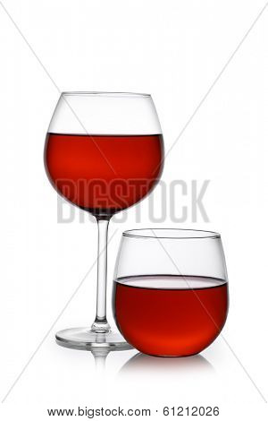 Red wine in traditional and stemless glasses cutout, isolated on white background