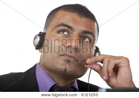 Call Center Agent Looks Contemplative