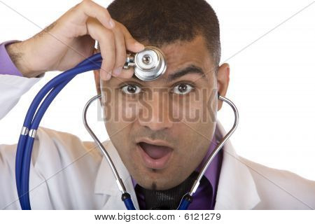 Medical Doctor Examins His Head With Stethoscope