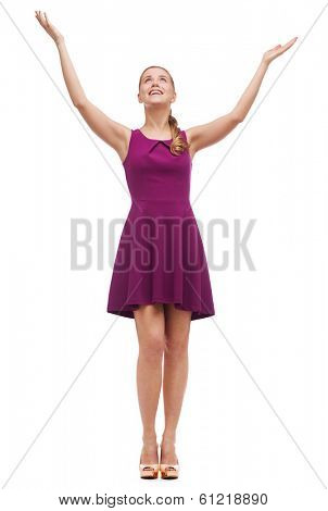 happiness and people concept - smiling young woman in dress waving hands