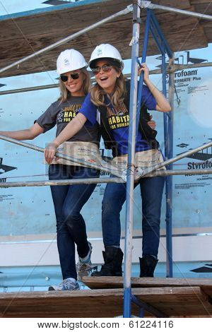 LOS ANGELES - MAR 8:  Kelly Sullivan, Lisa LoCicero at the 5th Annual General Hospital Habitat for Humanity Fan Build Day at Private Location on March 8, 2014 in Lynwood, CA