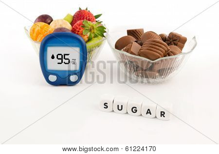 Glucometer And Bowl With Chocolates And Fruits. Healthy Lifestyle