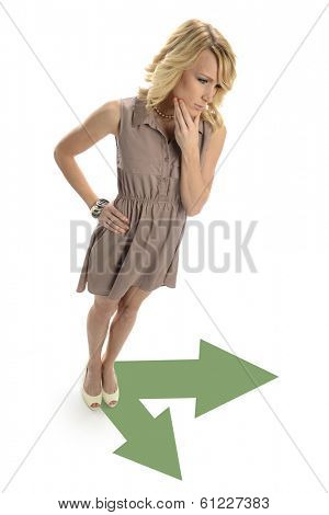 Young Businesswoman taking decisions about arrow directions isolated on a white background