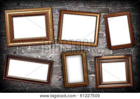 Messy Arrangement Of Frames On Wall