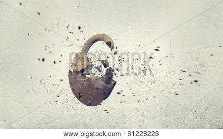 Conceptual image with stone broken lock on white background