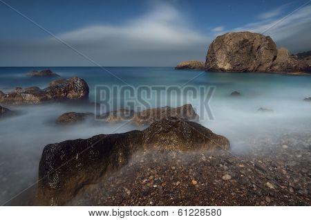 Sea landscape with rocks and cliffs. Moonlit Night on the seashore. Crimea, Ukraine, Europe
