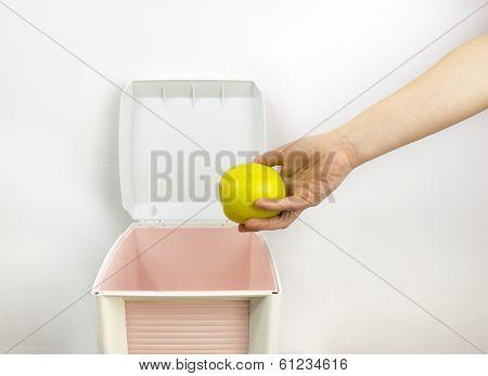 Throwing Food At Garbage