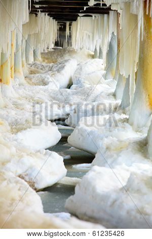 Winter Scenery. Baltic Sea. Close Up Ice Formations Icicles On Pier Poles