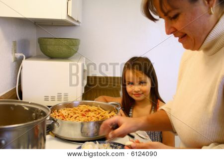 Little Girl Helping Mom Cook