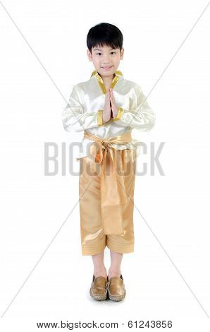 Asian Cute Boy In Thai Costume Acting Hello In Thai On White Background .