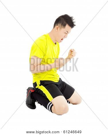 Young Soccer Player Make A Fist And  Yell