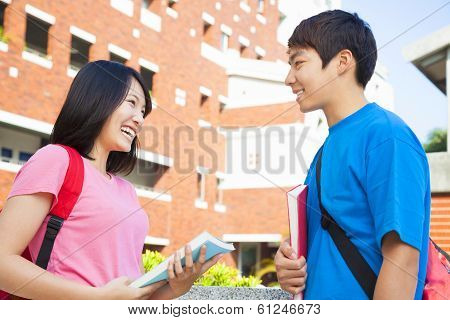 Two Students Or Friends Are Conversation Happily
