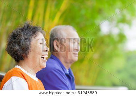 Happy Asian Seniors In The Park