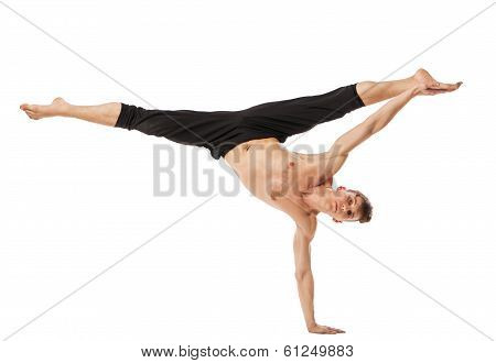 modern ballet dancer posing over white background