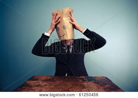 Businessman Putting A Bag On His Head