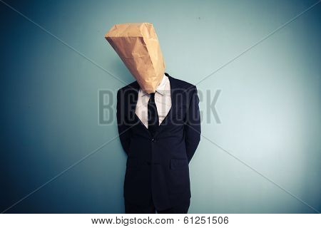 Sad And Ashamed Businessman With Bag Over Head