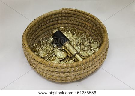 Gold Coins In A Basket With A Telescope