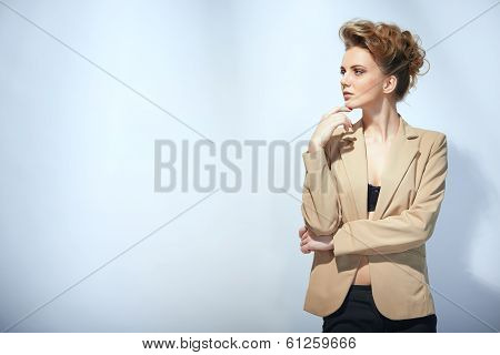 Pensive fashion woman with hand on chin