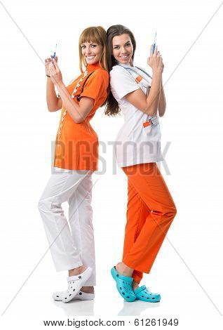Two nurse turning their backs on one another-with injection