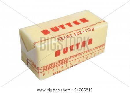 Stick of wrapped butter on white background