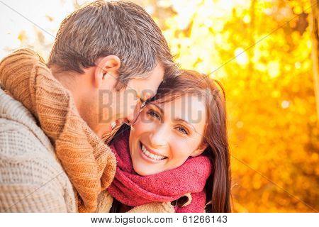 smiling cute couple in sundown sun