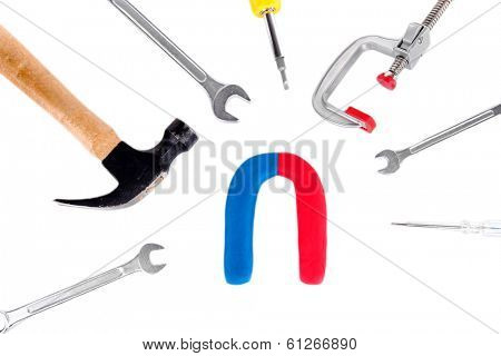 Horseshoe magnet with tools isolated on white