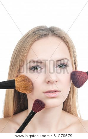 Makeup girl with blusher brushes