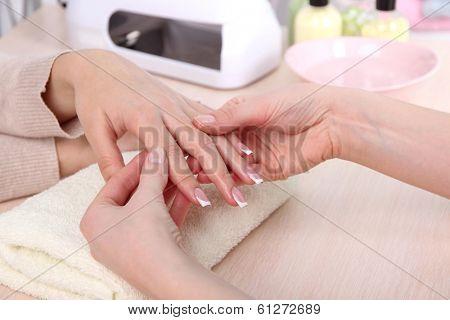 Manicure process in beauty salon close up