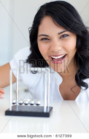 Smiling Businesswoman Playing With Newton Balls