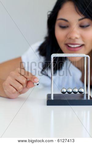 Businesswoman Moving Kinetic Balls