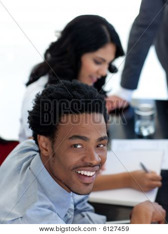 Smiling Ethnic Businessman In A Meeting