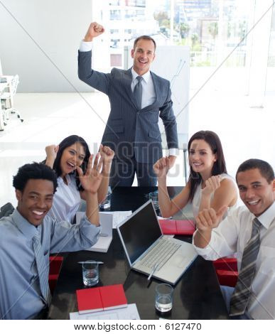 Business People In A Meeting Celebrating A Success