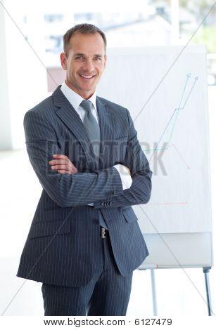 Senior Businessman Reporting To Sales Figures