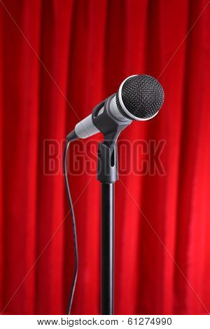Microphone with red curtain background