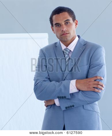 Serious Young Businessman Giving A Presentation