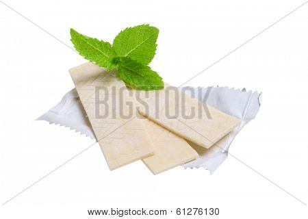 Chewing gum and mint leaves, cutout, isolated on white background