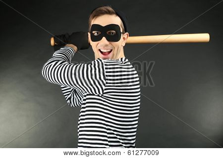 Thief on dark background