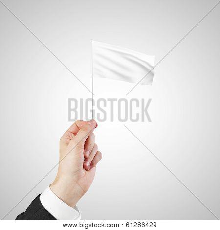 Hand Waving A White Flag