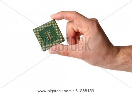 Hand holds computer CPU processor chip, cut out on white background