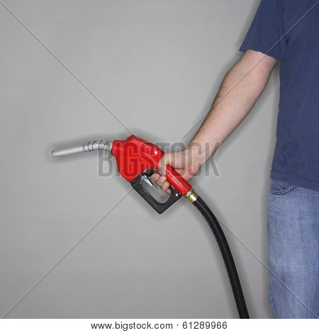 man in blue holding red gas hose and nozzle