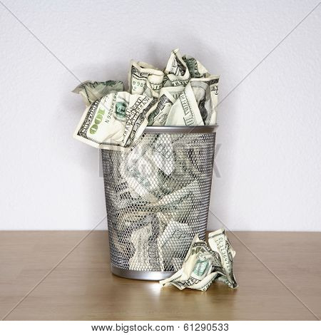 hundred dollar bills in trash bin