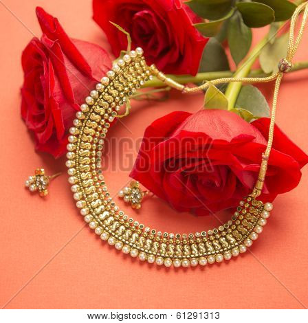 Indian gold ornaments with red roses