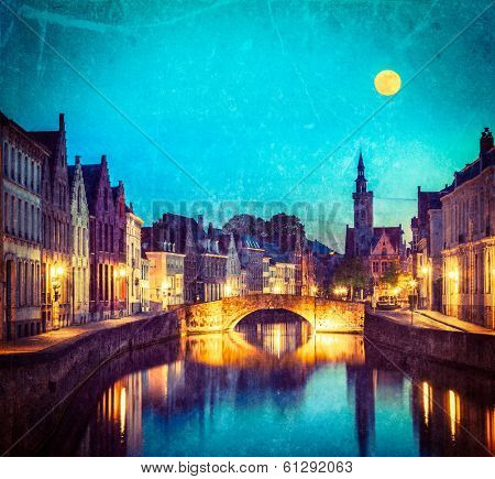 Vintage retro hipster style travel image of European medieval night city view background - Bruges (Brugge) canal in the evening, Belgium