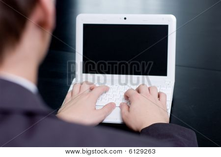 Businessman typing on his notebook