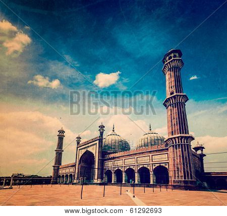 Vintage retro hipster style travel image of Jama Masjid - largest muslim mosque in India with grunge texture overlaid. Delhi, India