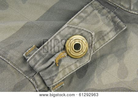 button on camouflage jacket