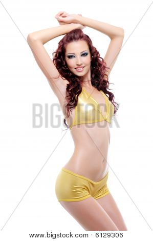 Charm Of Young Woman With Slender Body
